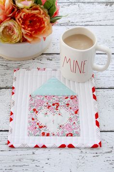 Celebrate Valentine's Day with this Heart and Home mug rug or mini quilt. this is such a cute project and great for beginners to sewing or quilting.