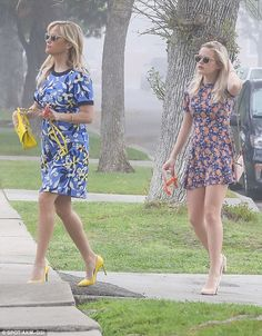 Fashionistas: Both mom and daughter sported similar floral skirts with spring just around the corner