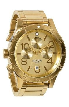 Dazzling, gold Nixon watch.