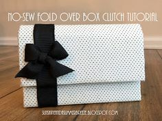 Sunshine and a Summer Breeze: No-sew Fold Over Box Clutch Tutorial. This is made with cardboard, fabric, and glue!!