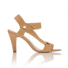 REBA VELCRO SANDAL  Nude leather/Acid trim  Mid-heel sandal with silver triangle hardware. Nude leather with acid stitching and acid velcro closure. 80mm covered heel and leather sole.  $375.00