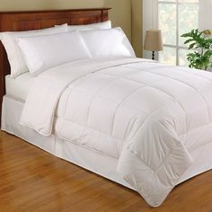 Wool Filled Cotton Comforter Size: King by Fresh Ideas. $139.99. FRE-611-XX-WHIT-04 Size: King Add warmth to your bedroom decor with a wool-filled comforter. Dry clean 100% wool filled and 100% cotton cover. Wool is the natural and renewable down alternative. They select the finest English wools and cover them with soft cotton covers. The result is a new modern way to sleep soundly in all seasons. Features: -All seasons pure wool filled comforter. -Filled with 15 lay...