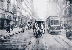 """""""Taken in 1917, this photo shows the end of the line for horse-drawn trams in New York City, as the changeover to electric cars (the streetcar on the right, for example) was all but complete. The caption contained with this public domain image reads as follows: """"Just before the last of these vehicles was banished from the streets of New York City, the photographer [Brown Brothers] snapped one of them as it passed alongside a 'Modern Electric Car.'"""