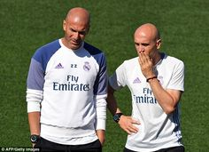 Real Madrid head coach Zinedine Zidane, left, alongside assistant coach David Bettoni