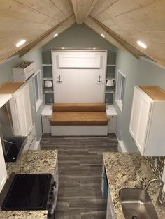 Murphy bed/sofa. Kitchen finishes could be taken down a notch to lower cost. Nice bathroom. Cornerstone Tiny Homes.