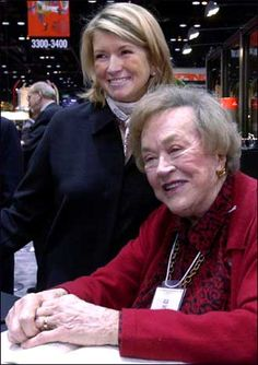 Julia Child poses for a picture with longtime friend Martha Stewart at the Housewares Show on Jan. 14, 2001, in Chicago.