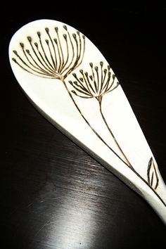 Wood burned wild flower spoons. $25.00, via Etsy.