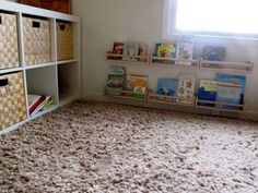 """Montessori at Home. The large silk screened """"seasons"""" canvas is the primary inspiration for the room.   Child-safe frames with our pictures in them at his height  Child-safe mirror at his height  Books accessible at his height  Low easy to climb on and off of bed  Clean room without a lot of """"stuff"""""""
