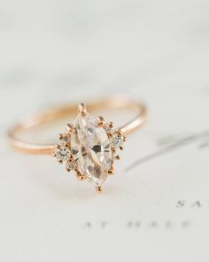 """The Wed List on Instagram: """"Give a little spark to your look by wearing this exquisite ring! Love how the marquise-cut is flanked with three small diamonds on each sides, all wrapped in a rose gold. Elegant with a hint of vintage! Who wants something like this too? Hands up! Photgoraphy by @lynndunston via @weddingchicks"""""""