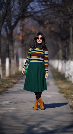 Colourful winter stripes: colourful turtle neck, sweater, stripes, striped sweater, green skirt, midi skirt, pleated skirt, winter outfit