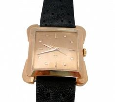 1950's Universal Geneve Yellow Gold Watch  Unisex 1950's Universal Geneve 18K Yellow Gold automatic 17 jewel movement wrist watch.  This unique square watch has a gold dial and  square and rectangle hash marks.  Case #10215, Serial#1662066. (Letters H.P.C. engraved on dial)  l Brown leather strap included.   One year guarantee on the movement only! Item Number: WOO603