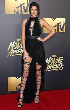 Kendall Jenner in a sheer black DSquared2 dress and lace-up sandals - click through for more best dressed from the MTV Movie Awards