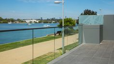 Glass balustrade with capping rail. Glass Balustrade, Curved Glass, Facade, Concrete, Outdoor Decor, Design, Home Decor, Decoration Home, Room Decor