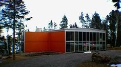 This orange house is built inside shipping containers with room for everything.