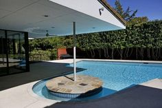 The Hayes House. Designed by Dallas architect Harold Prinz of the firm Prinz and Brooks and located in north Oak Cliff. The large and deep swimming pool retains its swim-up table.