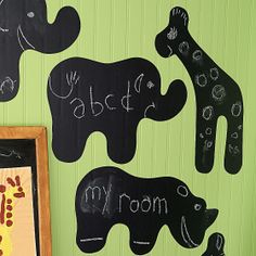 "Wall Candy  Chalkboard wall stickers.  Elephant 21""W; Giraffe 23½""H; Rhinoceros 22""W.  Chalkboard wall stickers can be reused and won't damage walls.  Imported.    Instant creativity! Draw a picture, leave a note, or play a game with this set of delightful chalkboard wall stickers. Fun animal shapes can be affixed to any surface in seconds, creating a space where kids can have blast writing on the wall. Chalkboard stickers remove easily without damage your walls, so they can be reused over…"