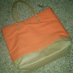Saks Fifth Avenue bag One of my favorites! Purchased on here in September NWT. Still im great condition! A little wear on the bottom, but no stains, rips, tears, etc. Canvas material. One zipper pocket and two open pockets inside. Make offer! Saks Fifth Avenue Bags Totes