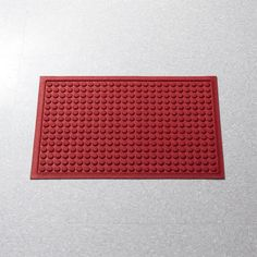"""This absorbent """"thirsty"""" mat with a fun carved dot design lives up to its name, indoors or out.  Unique construction wicks away moisture, trapping it in the pile for quick evaporation before floors, doorways or mudrooms get slick and dirty.  This long-lasting mat is finished with secure, non-skid rubber backing, keeps a low profile under opening and closing doors, and won't fade, crack, mold or mildew."""