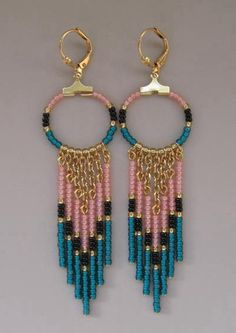 SALE! Was $16... now $12.50!  These beauties are made with matte dark teal , light opal peach, black, & golden seed beads, with gold plated cable chain, headpins & hoops.  They measure just under 3-1/2 long which includes the plated lever back ear wires, & 7/8 wide.