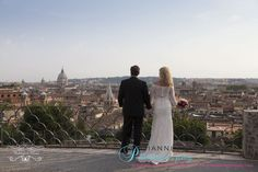 Mike and Laura from the US. Lovely photo followings their ceremony on a roof top in Rome. www.weddingsinrome.com