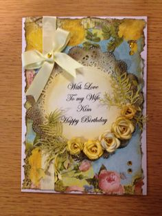 Yellow roses card by Sherie. Marianne createables roses die, anja leaves, McGill pine branch punch. Shop brought paper doily distressed with Tim Holtz distress inks.