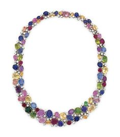 A MULTI-GEM AND DIAMOND NECKLACE, BY OSCAR HEYMAN & BROTHERS Designed as a bib necklace of circular, cushion and oval-cut peridots, rubies, amethysts, tsavorites, sapphires, purple and yellow sapphires and spinels, interspersed with circular-cut diamonds, 16 ins., mounted in platinum and 18k gold With maker's mark for Oscar Heyman & Brothers, no. 601642.