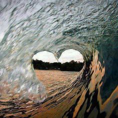 Surfing wave in shape of heart
