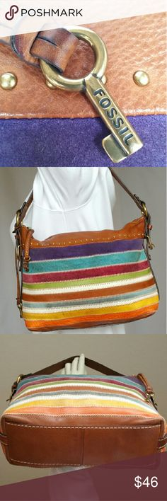 Fossil Leather Shoulder Bag Absolutely fabulous Fossil steady Eddie shoulder bag with all of the texture your heart desires. Let's see, there's multicolor suede rich pebbled leather, brass acutrements, nailheads, leather zip pulls original Fossil brass fob top zip close interior zip pocket as well as 2 interior slip pockets a happy exterior color palette AND it's in EUC shape. This bag is glorious! Just look at her! YUMMY! 10H 11.5W 10 DROP Fossil Bags Shoulder Bags