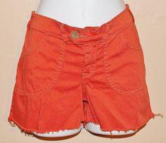 Distressed Burnt orange shorts ..fringed bottom by Forever peace