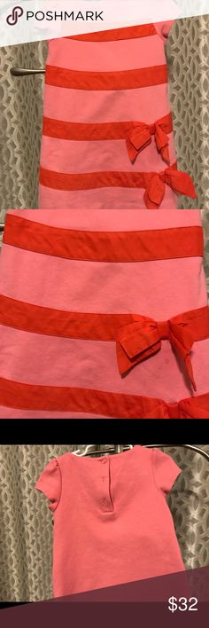 3T Janie & Jack Valentine dress This pretty in pink dress has gorgeous bright red/orange stripes with cute bow accents. It's an A line dress that is free to let your little girl be a little girl and be comfortable. The best part is how well this dress has held its color despite washing and ironing. I can't believe how new this dress still looks! You won't be disappointed in the least when you get this dress home. Thanks for viewing. Janie and Jack Dresses Casual