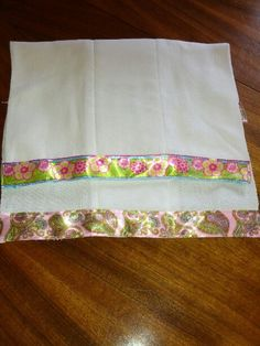 """Great new baby gift, burp clothes made out of cloth diapers.  Need 36'' of ribbon and 1 diaper for each.  Sew ribbon on to diaper, you will have a few inches extra at each side so neatly tuck ribbon in to wrap around the back about an inch. Easiest to start sewing on the ribbon on the edge then you can let the ribbon """"fall"""" into place."""