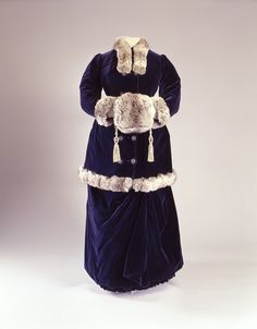 Mlle Lipman of Paris made this luxurious sapphire blue velvet ensemble trimmed with chinchilla for Miss C.L.W. French of Boston in 1880.