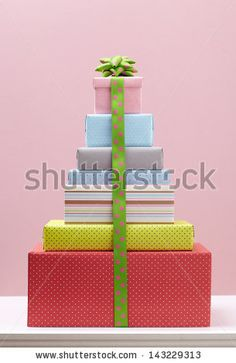 colored gift box with decorative bows on white table. Group of presents. Gift boxs with origami bows.