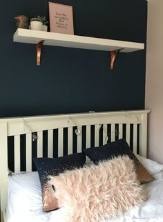 The navy, rose gold, blush pink colour combination feels like it could be too much but broken up with some white, it's the perfect decor for a teenage girl's bedroom.