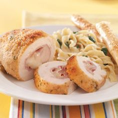 Italian Chicken Roll-Ups (rolled up with Ham & Prov Cheese and Rolled in Bread/Parm/Parsley)- Just made these with my son John for Sunday Lunch!  They were FAB!  Served with Buttered Rice, Spinach (Buttered, S & Nutmeg- of course!) and Sauteed Peach Slices (with honey & cinnamon!)  Finished the meal with a homemade Choco-Ice Cream Roll Cake (made entirely by John!) YUMMLY CHUMMLY!!!!