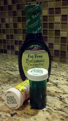 FINALLY!  A great container for on-the-go salad dressing.  Take a used pill bottle and peel off the label. Voila!