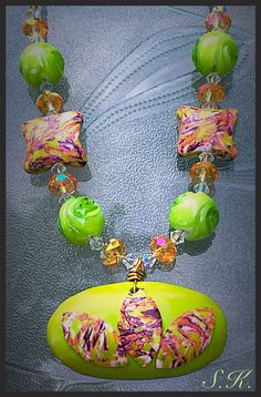 Colorful polymer clay necklace, in wonderful complimenting colors of pinks, green, red and mauve with a unique style and pattern of beads. by Valleycrafttreasures on Etsy