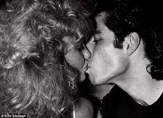 Summer loving: Olivia Newton John and John Travolta kiss at the opening of Grease