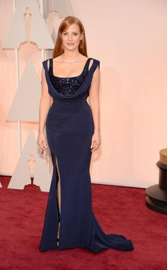 """Jessica Chastain brought plenty of glamour to the red carpet in a figure-hugging navy Givenchy dress at the Oscars on Feb, 22, 2015. The """"A Most Violent Year"""" actress was at the star-studded event to present an award at the star-studded ceremony."""