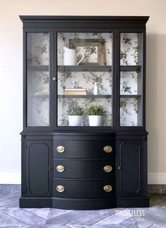 """""""Federal style bow front china cabinet painted in Lamp Black (exterior) and Queenstown Gray (interior). The back of the piece was lined with a gray floral Magnolia Homes wallpaper. Sealed with HPTC in Flat."""" - VintagelessJules"""