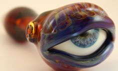 It's a pipe, when in use, the eye turns red
