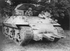 M10 Tank Destoryer equipped with the T1E1 Rhinoceros hedgerow cutter, prior to Operation Cobra, in France, circa mid-July 1944.