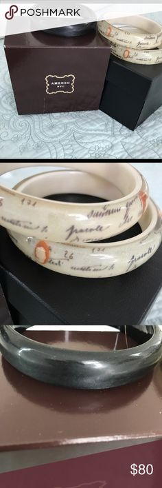 """Amedeo NYC set """"Lettera D'Amore"""" bangle set Amedeo NYC from the """"Lettera D'Amore"""" Collection resin bangles Set of3 Two are inlaid with genuine cameos and French language. These unique and difficult to find complete set. Plain bangle is pearl black-plain no cameos size approximately 8 inches. Very good condition-no scratches. Amedeo NYC Jewelry Bracelets"""