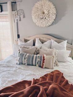 Are you looking for ways to style your bed? These pillows are so cozy and super affordable! Love these farmhouse master bedroom pillows, makes me want to take a nice long nap! #masterbedroom #masterbedroombedding #farmhousedbedding #farmhousebeddingideas #farmhousebedroomdecor #pillowideas #pillowtassels