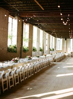 Cute wedding reception. I love long tables where everyone sits together!