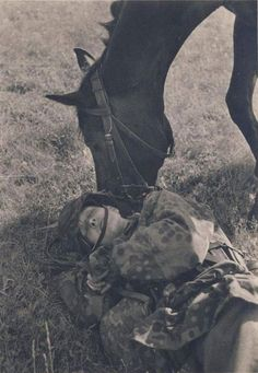 """Soldier of the 8th SS Cavalry Division """"Florian Geyer"""" and a horse. True friendship."""