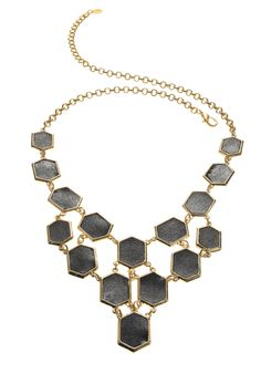 The right piece of statement jewelry can make all the difference