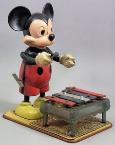 "A Marx Toys mechanical ""Mickey Mouse playing Xylophone"" toy on painted metal base 