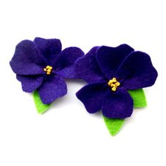 Cute violets, made from felt. Would make a cute pin or hair thing