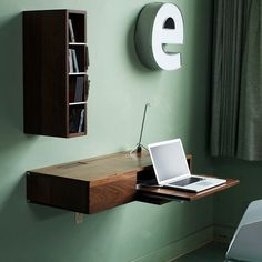 Ledge Wall System  A simple, streamlined desk or media console. Very modern. I love it!